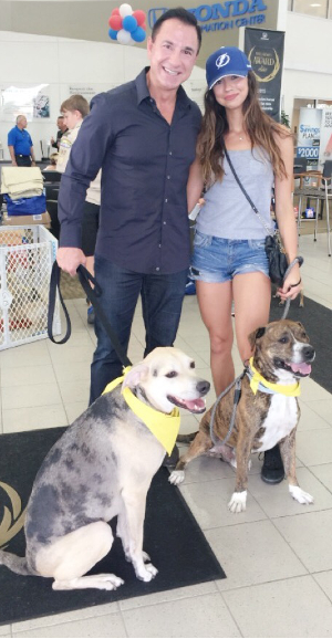 John Marazzi and Marissa Marazzi with rescue dogs Zeus and Athena at Just One Day 2016